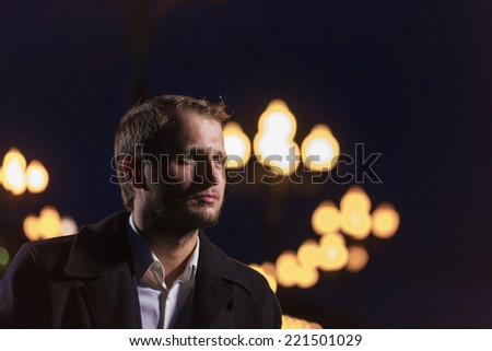 Portrait of the man with lanterns - stock photo
