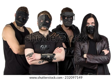 Portrait of the metal band in masks on white background - stock photo