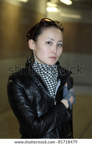 Portrait of the modern young Asian woman in underground transition - stock photo