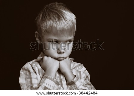 Portrait of the offended boy. - stock photo