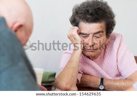 Portrait of the old sad woman - stock photo