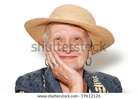 Portrait of the old woman in a hat on a light background - stock photo