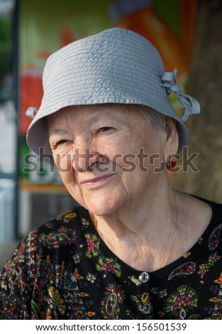 Portrait of the old woman. Outdoors - stock photo