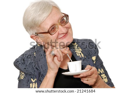 Portrait of the old woman with a coffee cup on a light background Portrait of the old woman with a coffee cup on a light background - stock photo