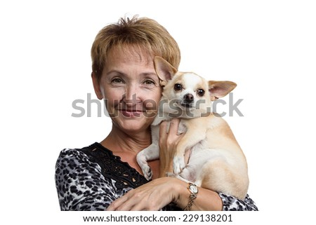 Portrait of the old woman with the small dog on white background - stock photo