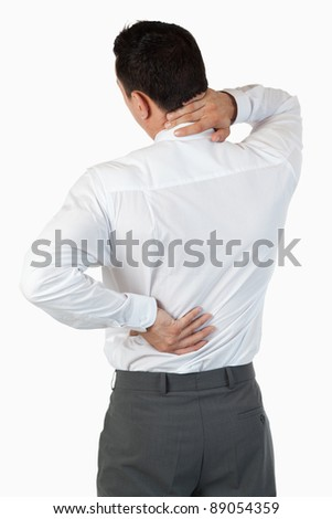 Portrait of the painful back of a businessman against a white background - stock photo