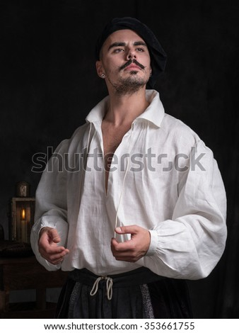 Portrait of the Poet. A man in a white shirt and wearing a hat. Historical costume.