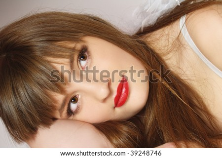 Portrait of the pretty girl in white clothes - stock photo