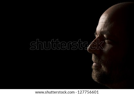 Portrait of the profile of a man who is thoughtful