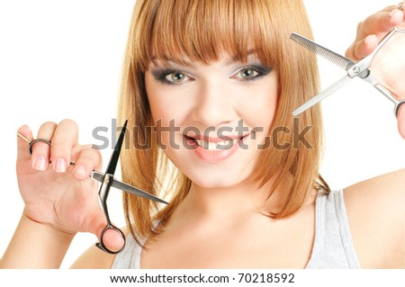 Portrait of the red hair women with hairdresser's scissors isolated on a white background - stock photo