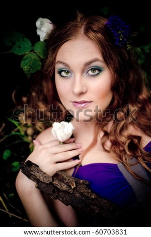 Portrait of the red-haired girl in wood - stock photo