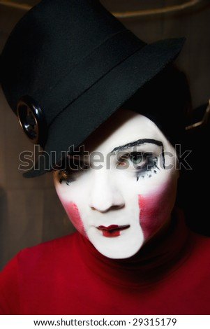 Portrait of the sad mime in a hat