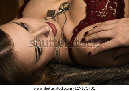 Portrait of the sexy woman in a medieval castle interior