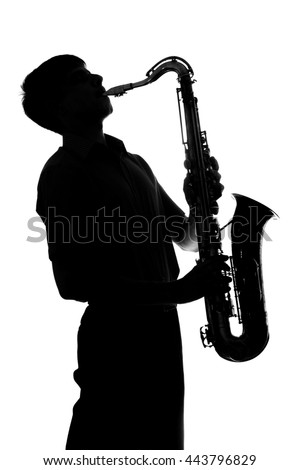portrait of the silhouette of a young man in a suit playing a wind instrument