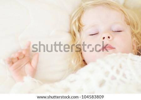 Portrait of the sleeping beautiful baby girl - stock photo