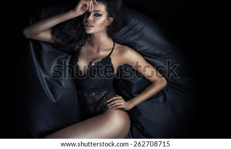 Portrait of the slim woman wearing sexy lingerie - stock photo