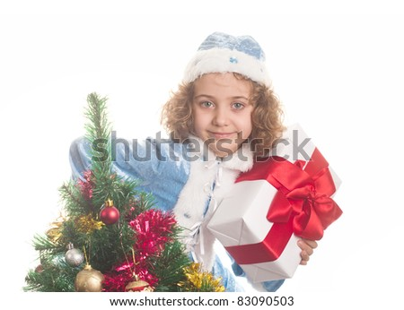 Portrait of the small beautiful girl in the dress of a Snow Maiden