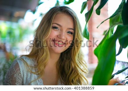 Portrait of the smiling beautiful blue eyed girl - stock photo