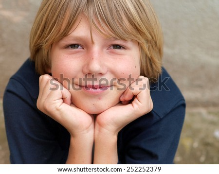 Portrait of the smiling boy. - stock photo