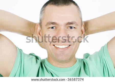 Portrait of the smiling man on a white background - stock photo