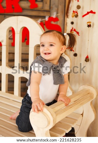 Portrait of the smiling one year old baby girl indoor - stock photo