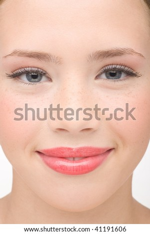 Portrait of the smiling young girl close up - stock photo