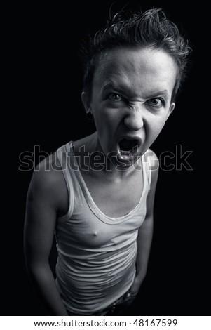 Portrait of the strange expressive girl on a dark background - stock photo