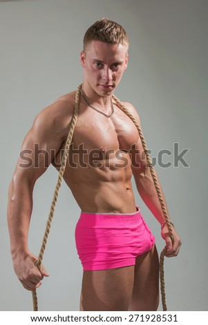 Portrait of the strong guy with a cord - stock photo