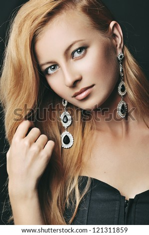 portrait of the stylish woman with beautiful hair and luxury jewelry