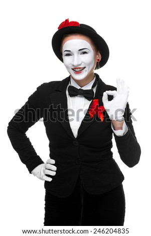 Portrait of the surprised and joyful woman as mime isolated on white background. Concept of approval and recommendations - stock photo