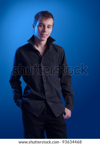 Portrait of the teenager in a dark shirt - stock photo