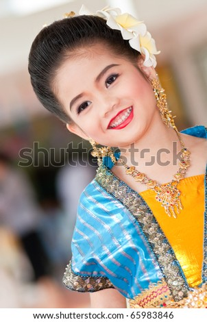 Portrait of the Thai beautiful girl in Thai traditional suit, Thailand.