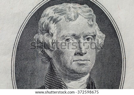 Portrait of the third US President Thomas Jefferson on two-dollar banknote bill, background of the money, two dollar bills front side obverse. background of dollars, close up, America