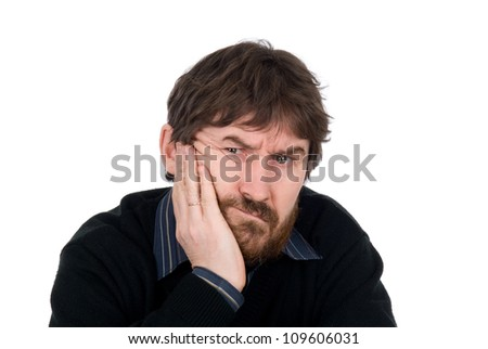 Portrait of the thoughtful bearded man with a hand on a cheek.Isolated on a white background - stock photo