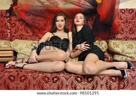 Portrait of the two beautiful women in oriental interior - stock photo