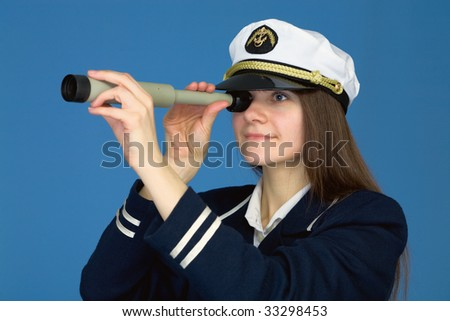 Portrait of the woman - captain with telescope on a blue background