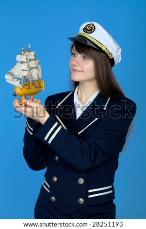 Portrait of the woman in a sea cap with the ship in hand