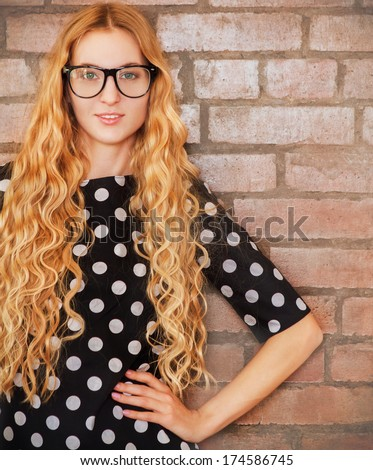 Portrait of the woman wearing black eye glasses looking at camera - stock photo