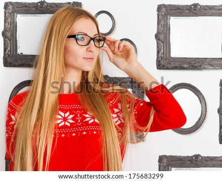 Portrait of the woman wearing black eye glasses looking forward - stock photo
