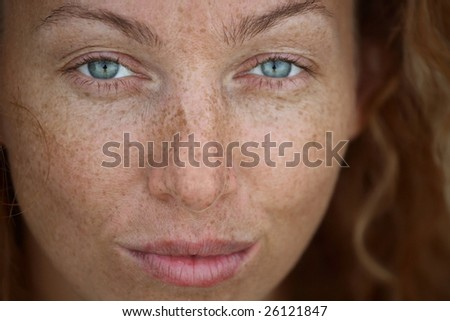 Portrait of the woman with freckles - stock photo