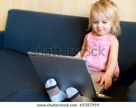 Portrait of the 2 years old girl with notebook - stock photo