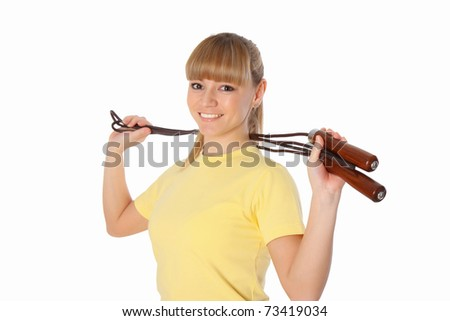 Portrait of the young attractive woman doing sports exercises on white - stock photo