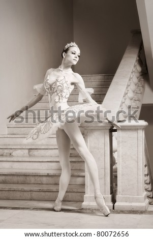 Portrait of the young ballerina in ballet pose