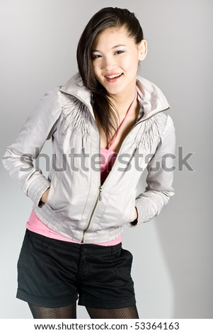 Portrait of the young beautiful brunette - stock photo