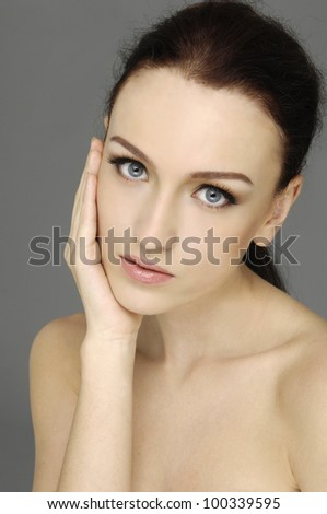Portrait of the young beautiful girl� grey background.
