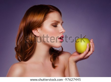 Portrait of the young beautiful  girl with green apple - stock photo