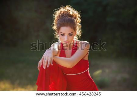 Portrait of the young beautiful smiling woman outdoors enjoying summer sun. Young woman outdoors portrait. Beautiful blonde woman outdoor - stock photo