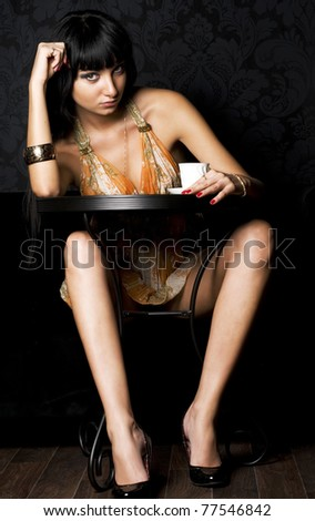 Portrait of the young beautiful woman in the cafe - stock photo