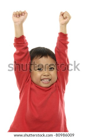Portrait of the young boy holding hands up, - stock photo