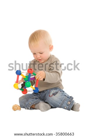 portrait of the young boy playing with a educational toy isolated on a white background
